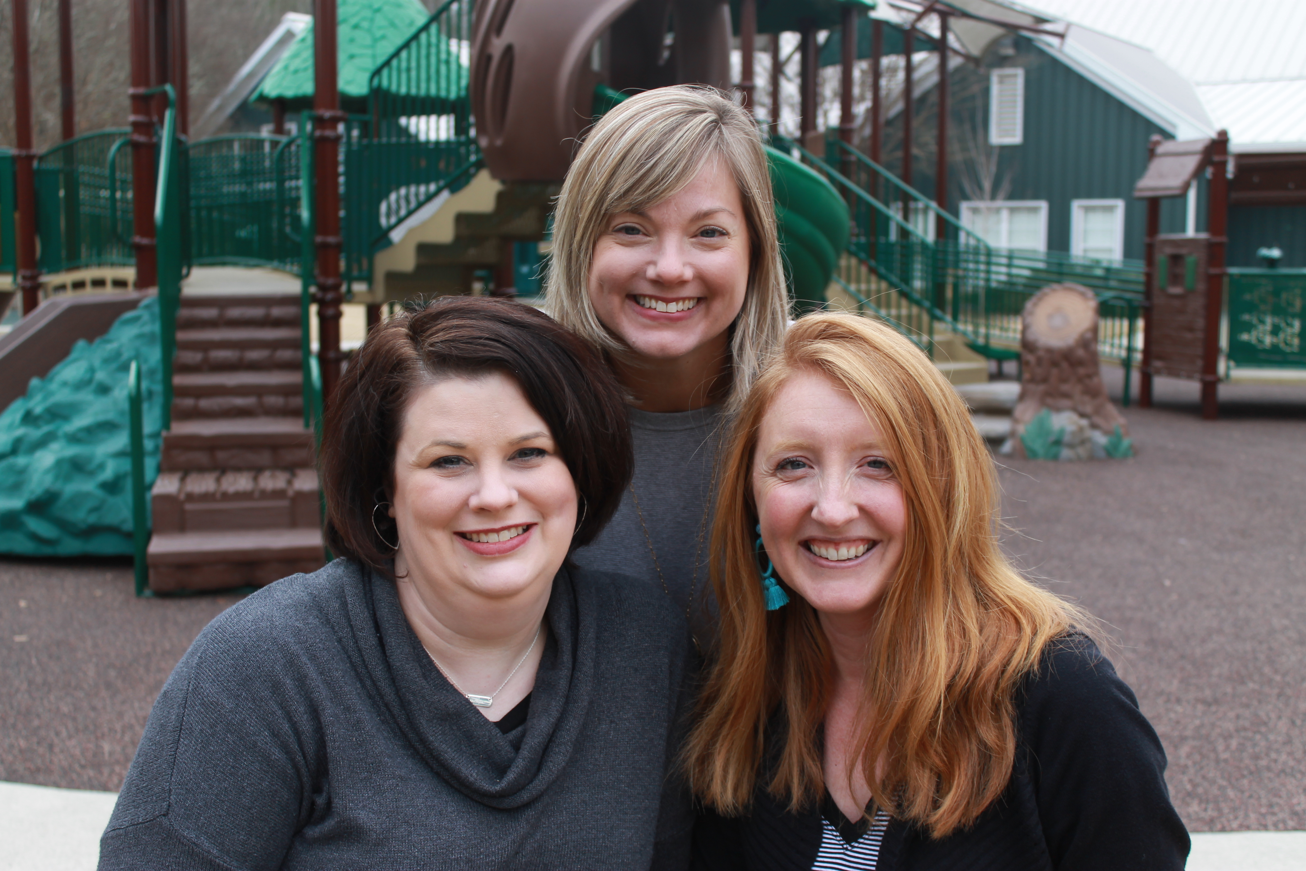 Lynn Roebuck, Meredith Hankins, and Melissa Pouncey outside at a playground